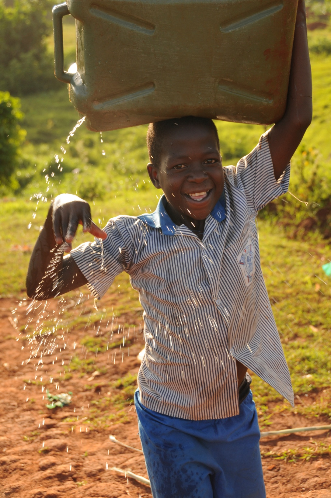 Boniface carrying his water up the hill.