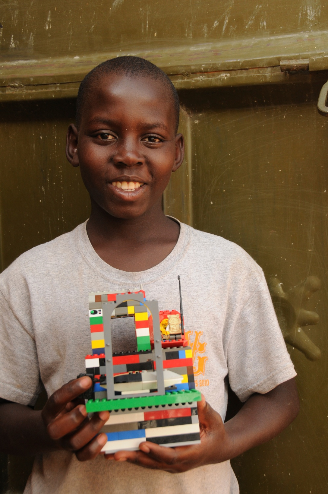 Musa and his house he will build when he gets to America. He is determined for someone to bring him here.