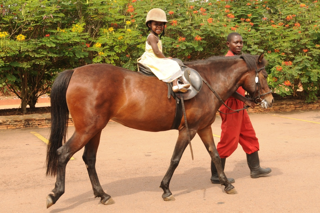 Kira was riding her pony in Uganda.