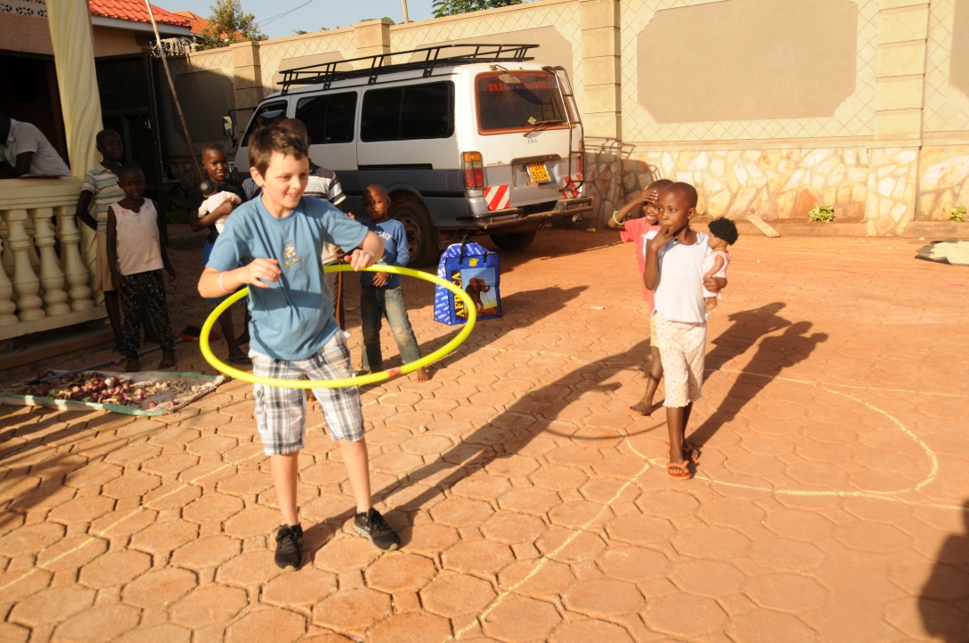 Jack is teaching the kids hoolahoop. In a few days many of them were challenging him to a contest.
