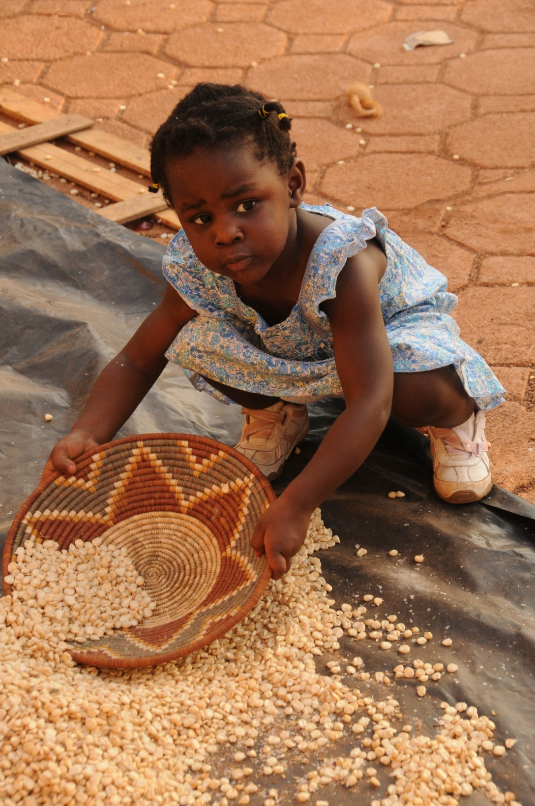 She was helping clean the maize on our last trip in Uganda. This is maize our children helped to grow!