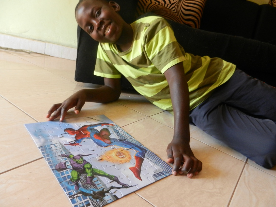 Musa and the children love to do puzzles.