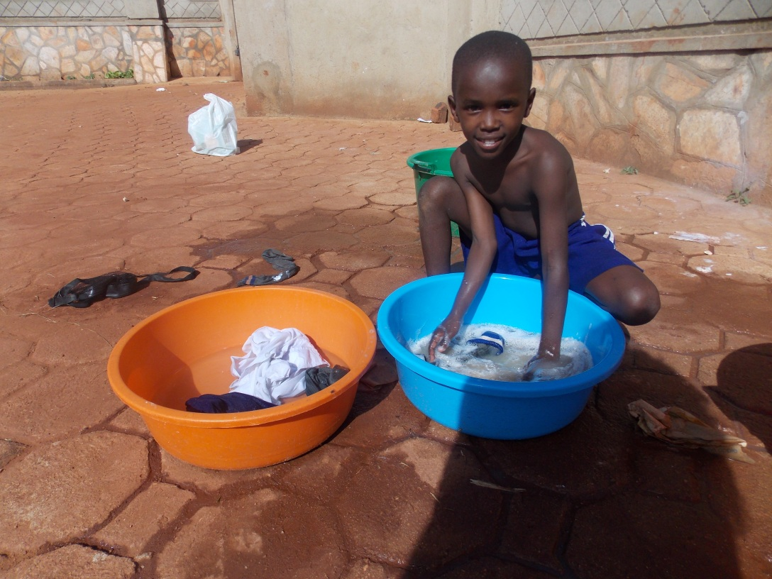 Desire is doing laundry. All of the children help with this chore. They seem to always do it with a smile.
