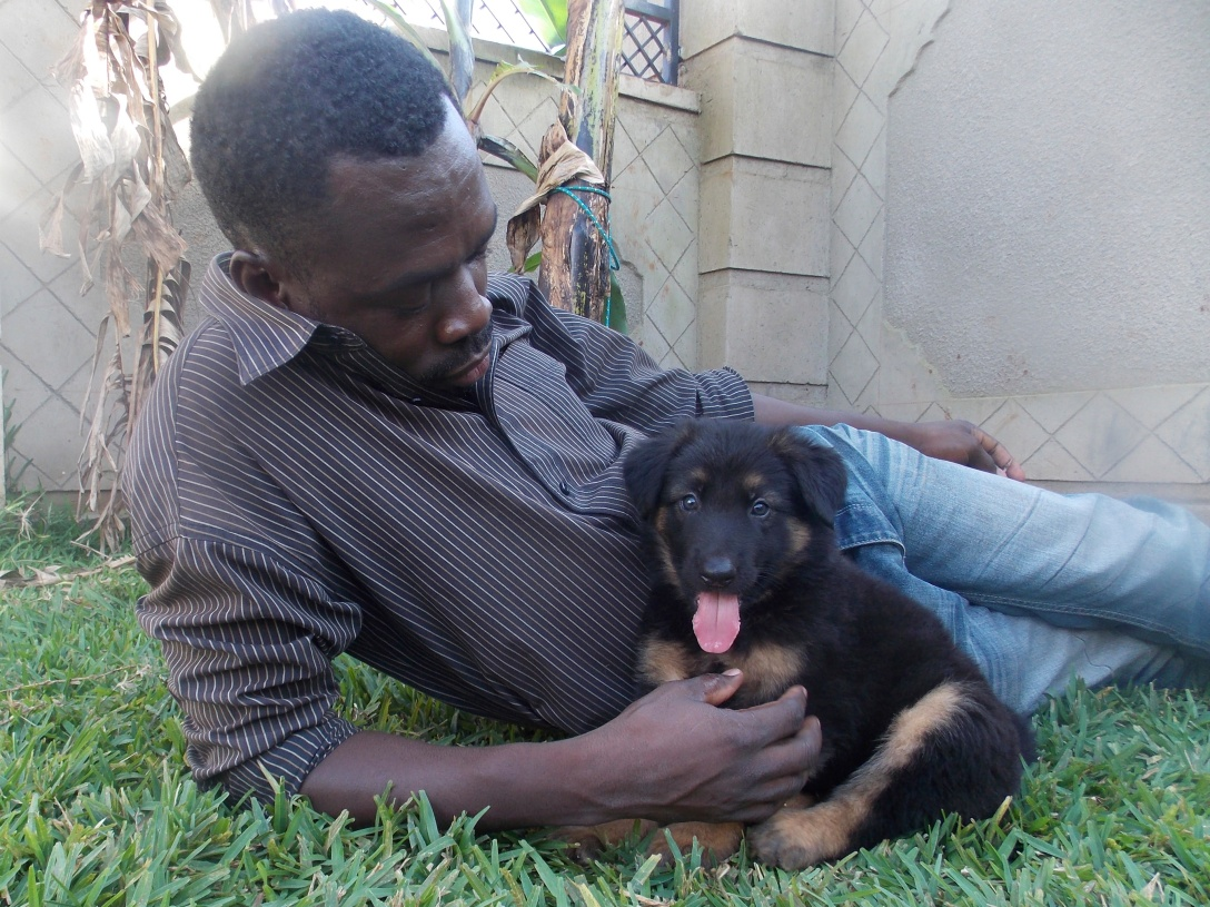 Robert has a tender heart for children, ministry and animals. I love this picture of him with Samson.