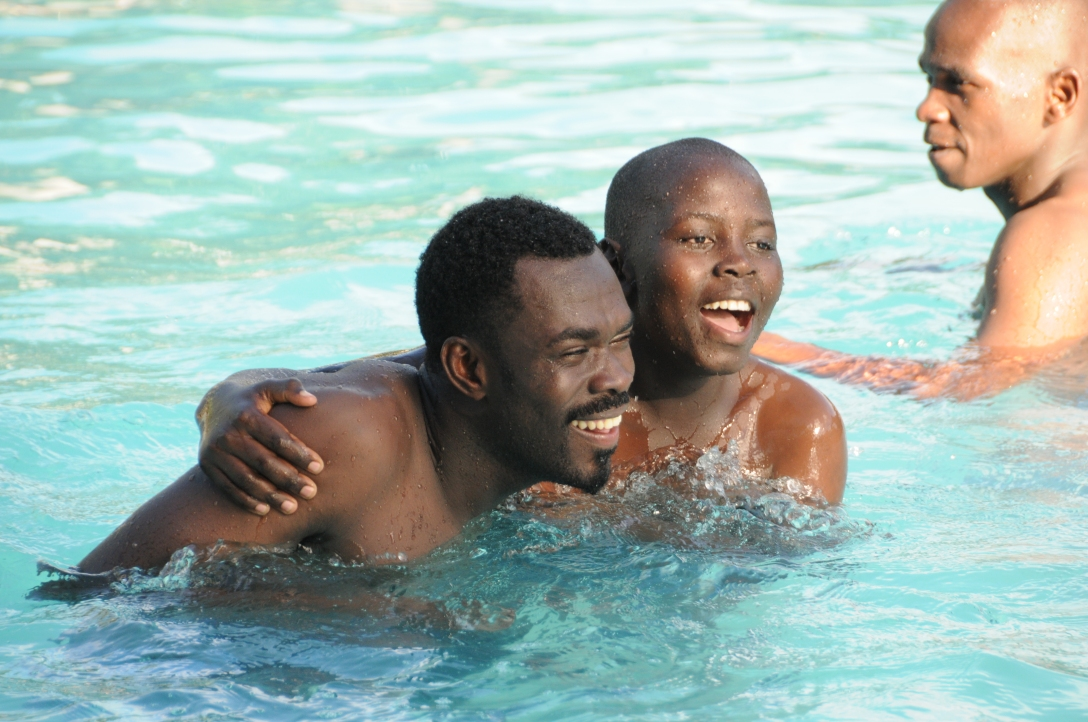 Robert and Musa swimming