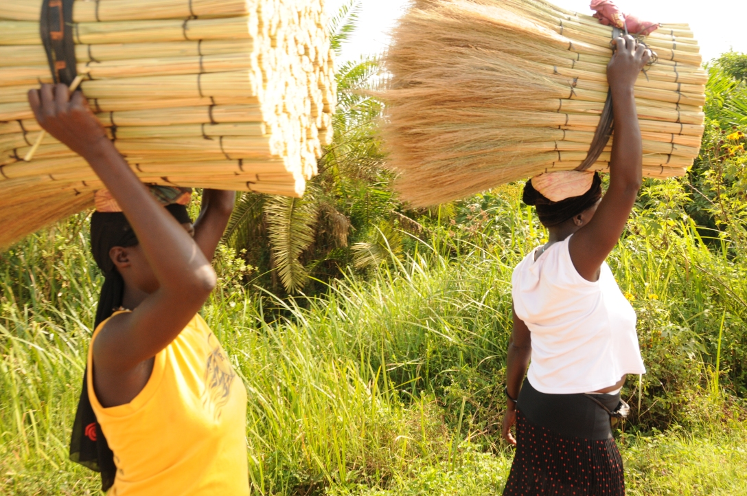 women with brush brooms on their heads for sale