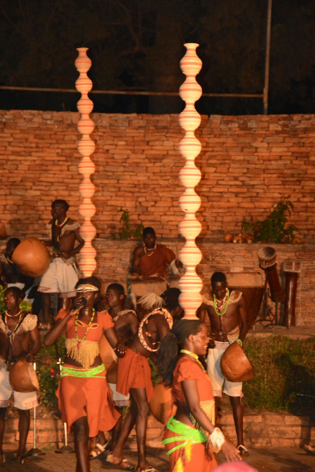 the show closes with ladies adding clay pots to their heads and dancing. They still shake the hips and climb stairs with ten pots on their heads!