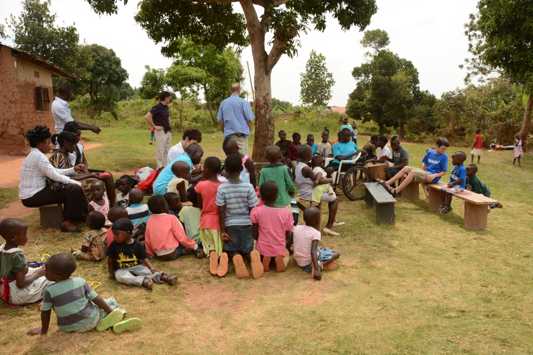 gathering under a tree to learn.