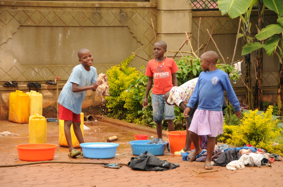 our children at Kirabo Seeds doing the laundry