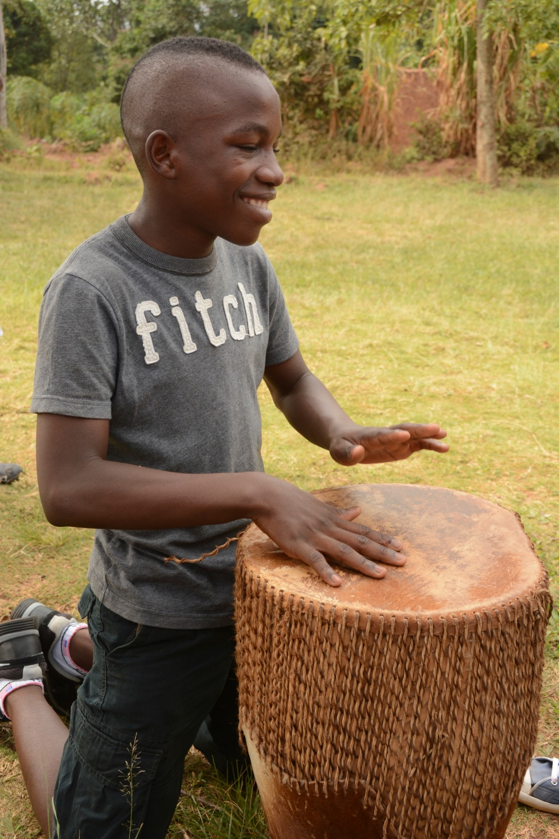 ronald was so happy when we brought a drum home for the family devotionals