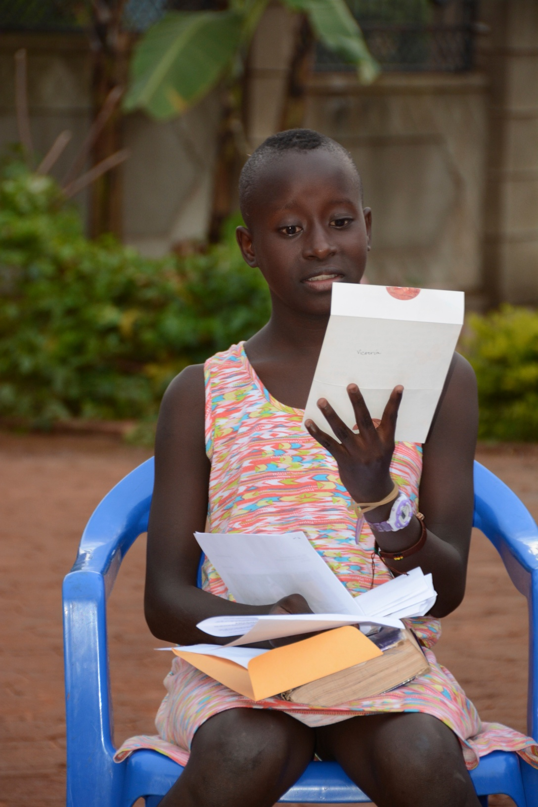 Angela is reading letters from her sponsors. Oh the kids were so happy to receive mail!