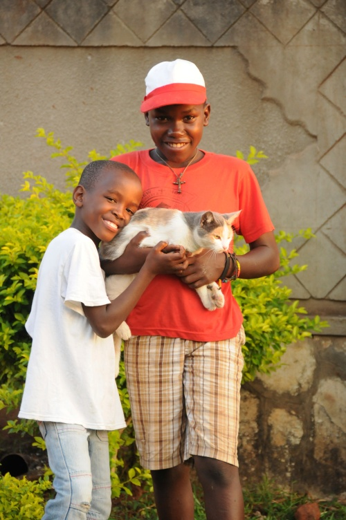 """Here's Daniel and Desire with their kitty, """"pretty"""" she's a social kitty who spends all her time around the kids"""