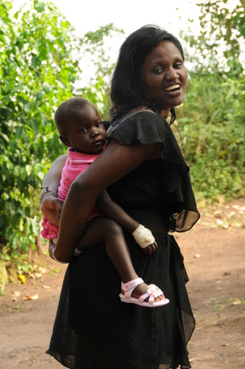 Phiona and Rhonah traveling Ugandan style. I love to do this with Kira in America. It's the best way to carry a child.
