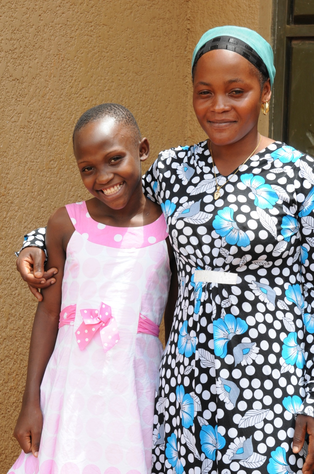 Victoria with her big sister who raises her two younger siblings and several children of her own by herself. Jack now sponsors their brother to go to school.