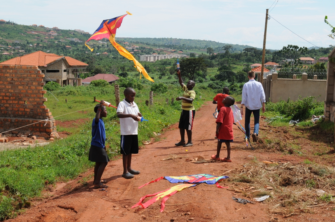 He taught the children to fly kites