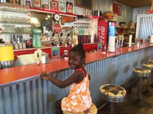 kira at the soda counter in Fort Davis Texas