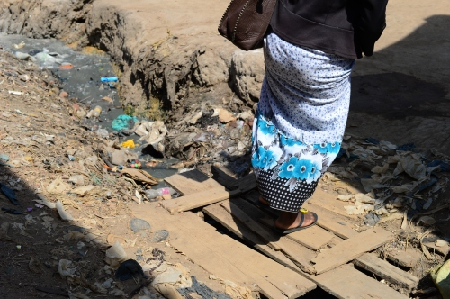 this is Irene crossing the bridge in the neighborhood over the sewage