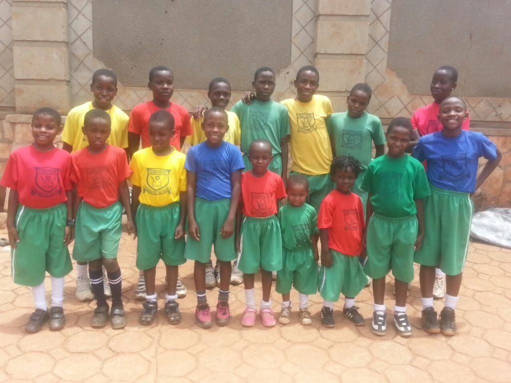 Kids in their sports uniforms. Fred and Musa go to boarding school we miss them during school time!!