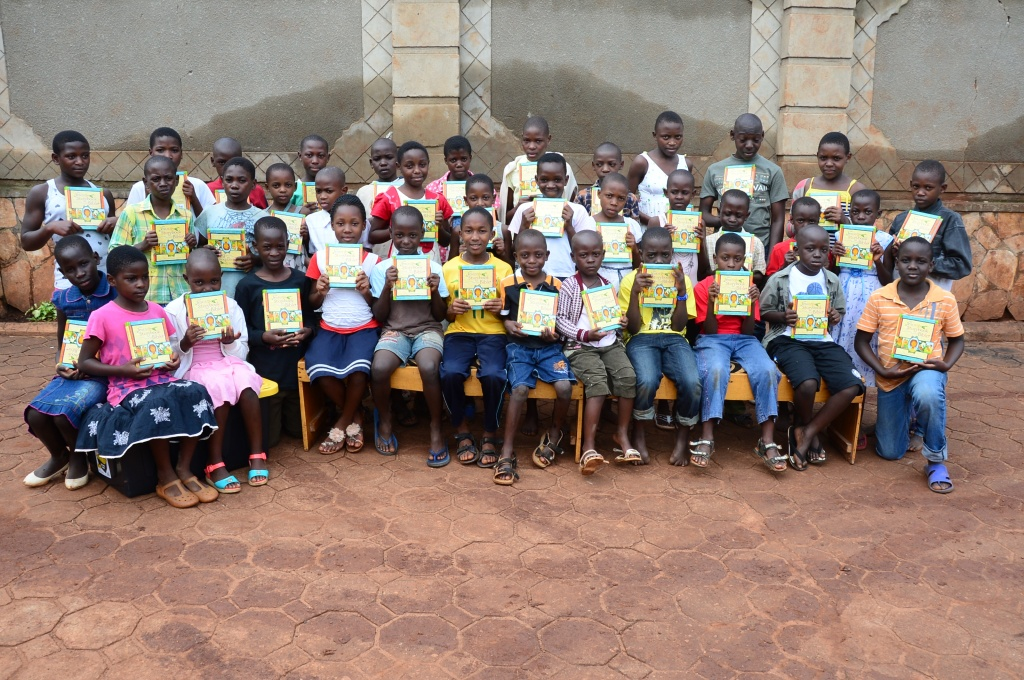 We gave new bibles to the community children.