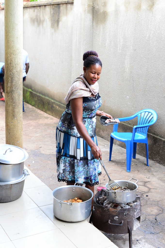 Judith cooking outside the kitchen door. They love to use the sigiri stoves outside