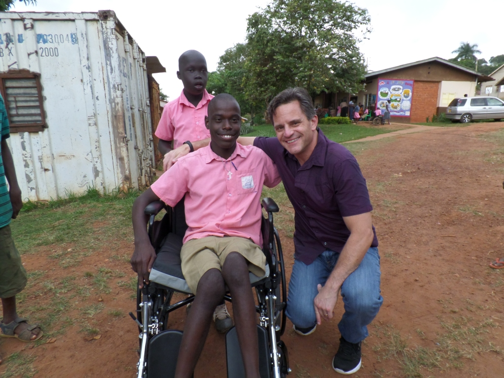 Darren and Craig visited Fred's school. Darren's friend donated a new wheel chair for Fred!