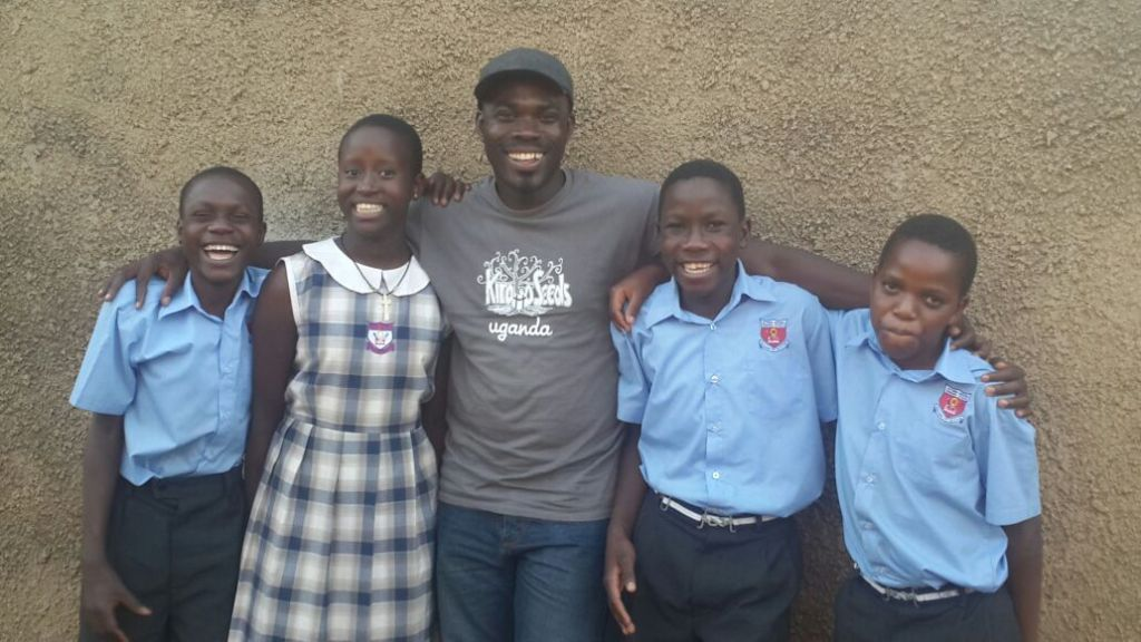 Robert with some of the kids in their school uniforms