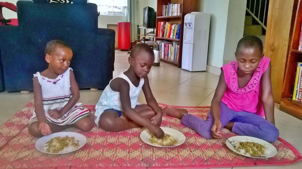 littles eating on the mats using their hands like they do in the village. (we do have forks they just like it this way sometimes)